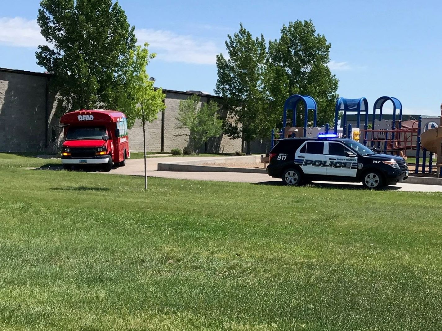 The West Fargo Police Department provided The Little Red Reading Bus a special escort.