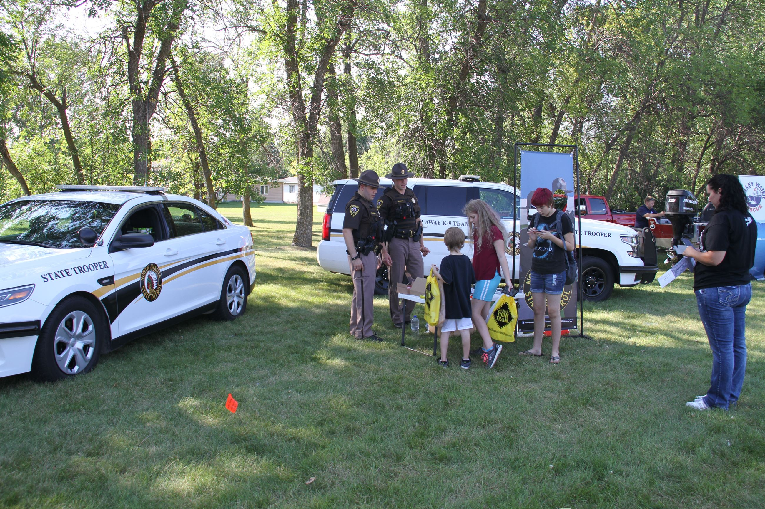 The North Dakota Highway Patrol visits with attendees.