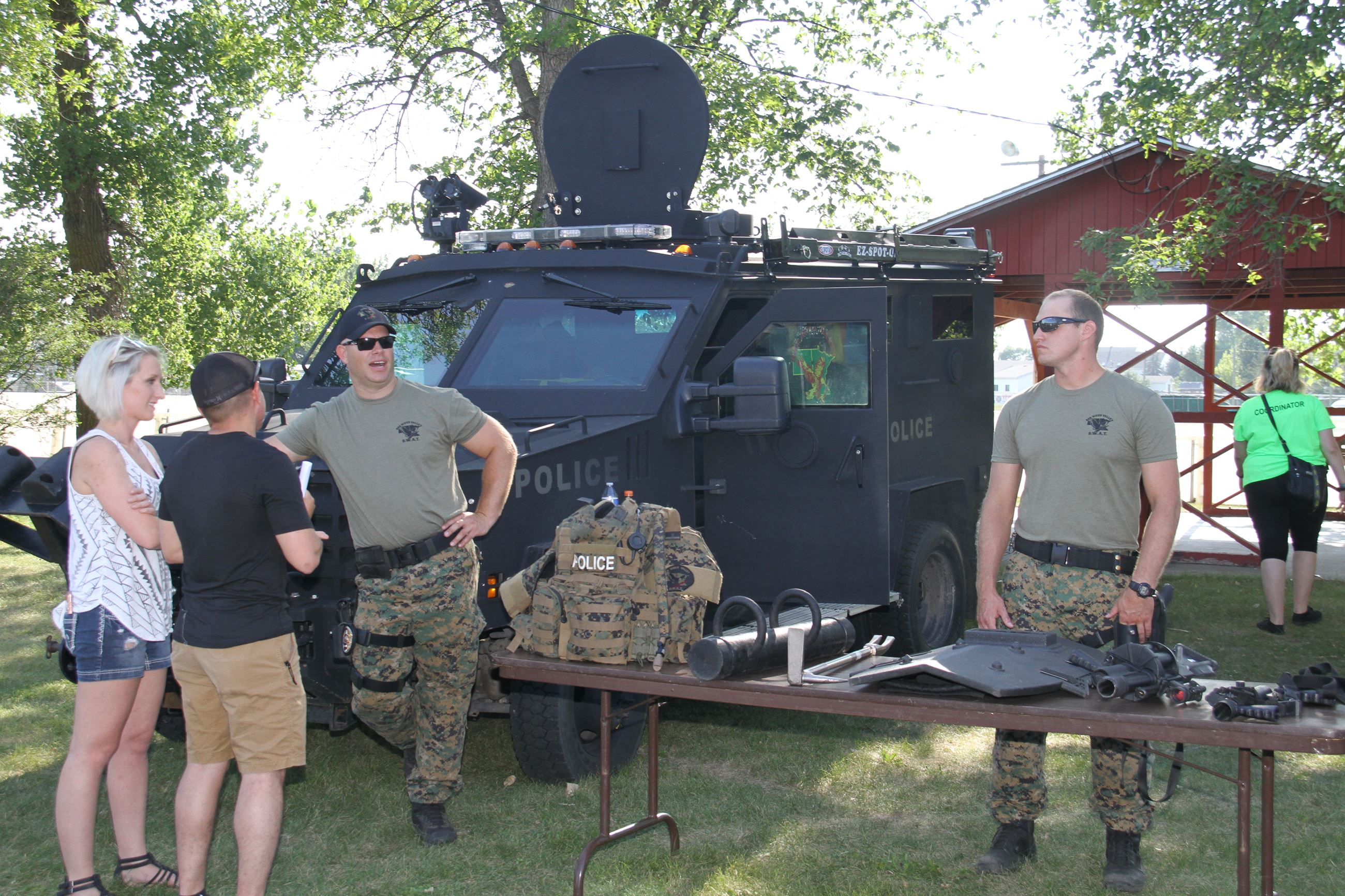 SWAT team members visit with attendees