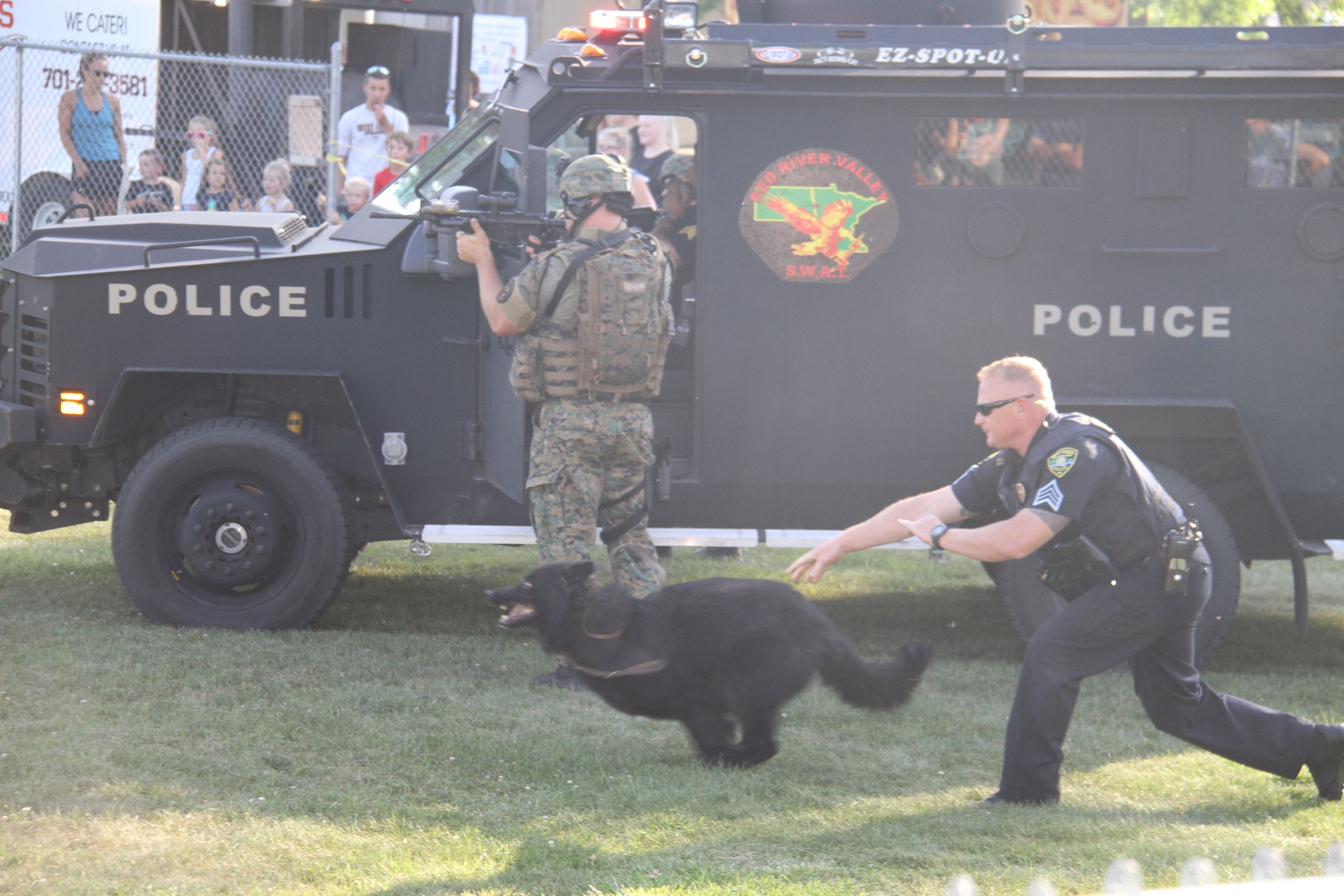 Sgt. Nielsen releases K9 Disco in a SWAT Team demonstration