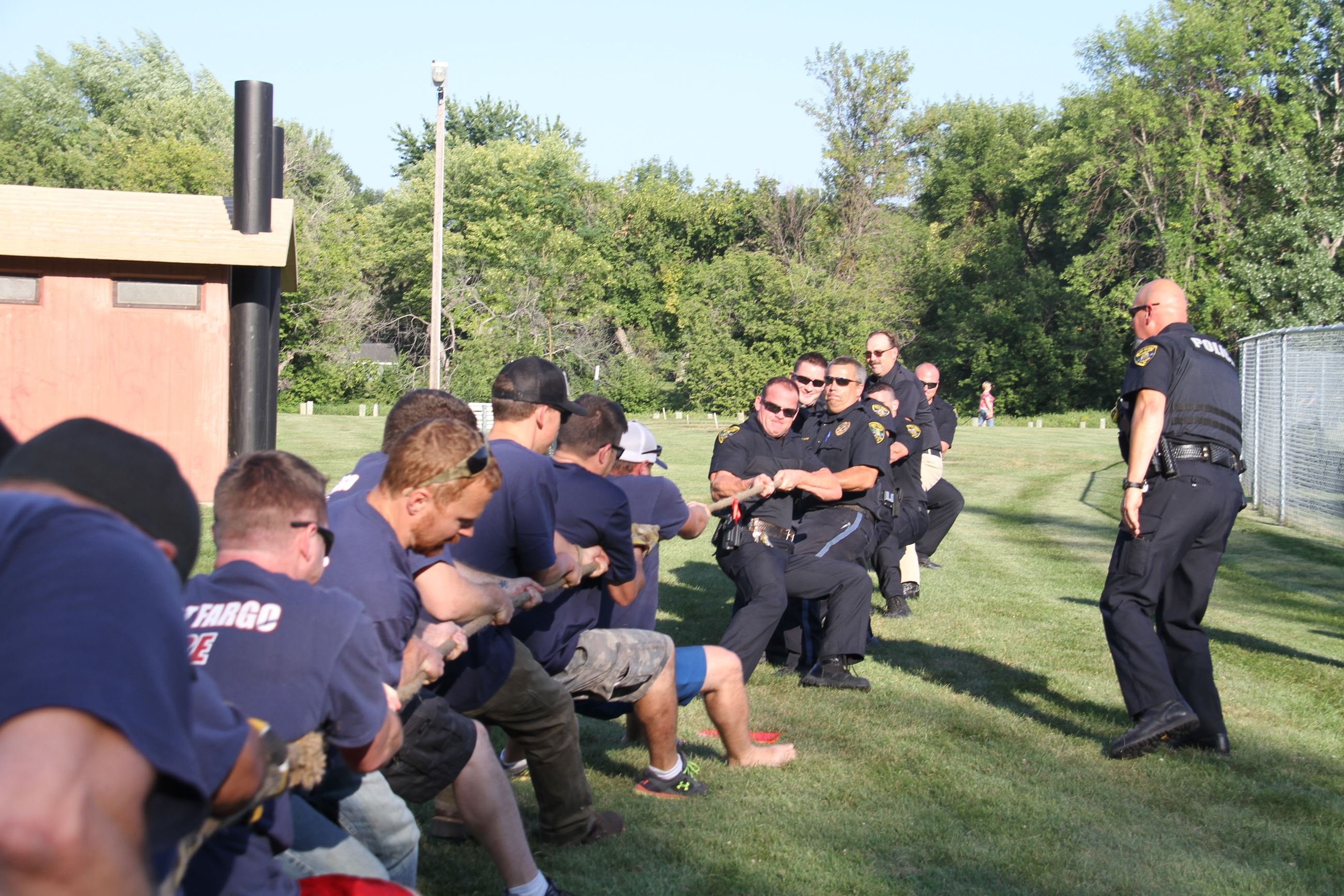 Lt. Anderson leads the police department in tug of war against the fire department