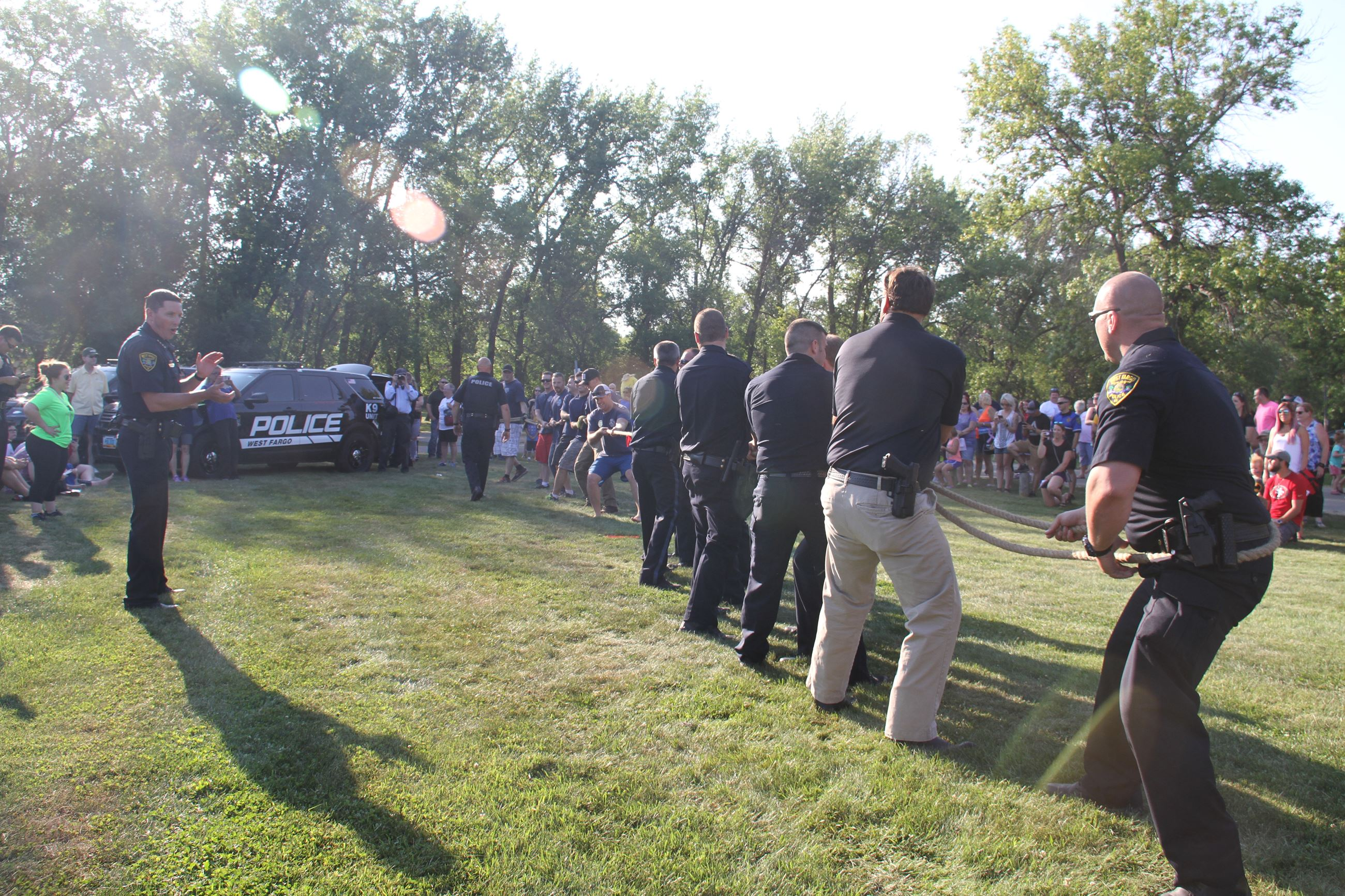 Chief Janke cheers on the West Fargo Police Department as they battle the West Fargo Fire Department in tug of war