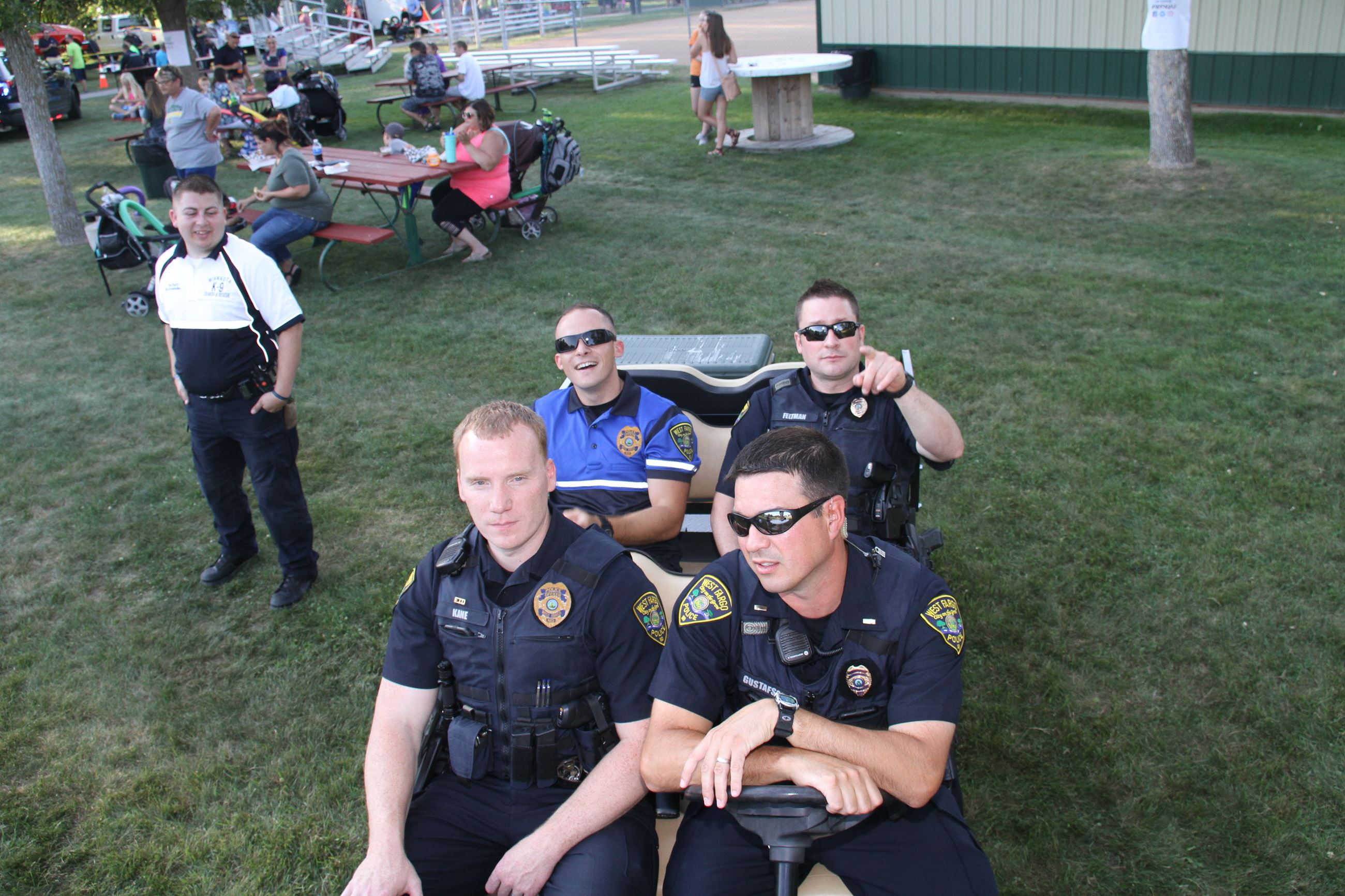 West Fargo Police Department officers prepare to join the crowds of Night to Unite