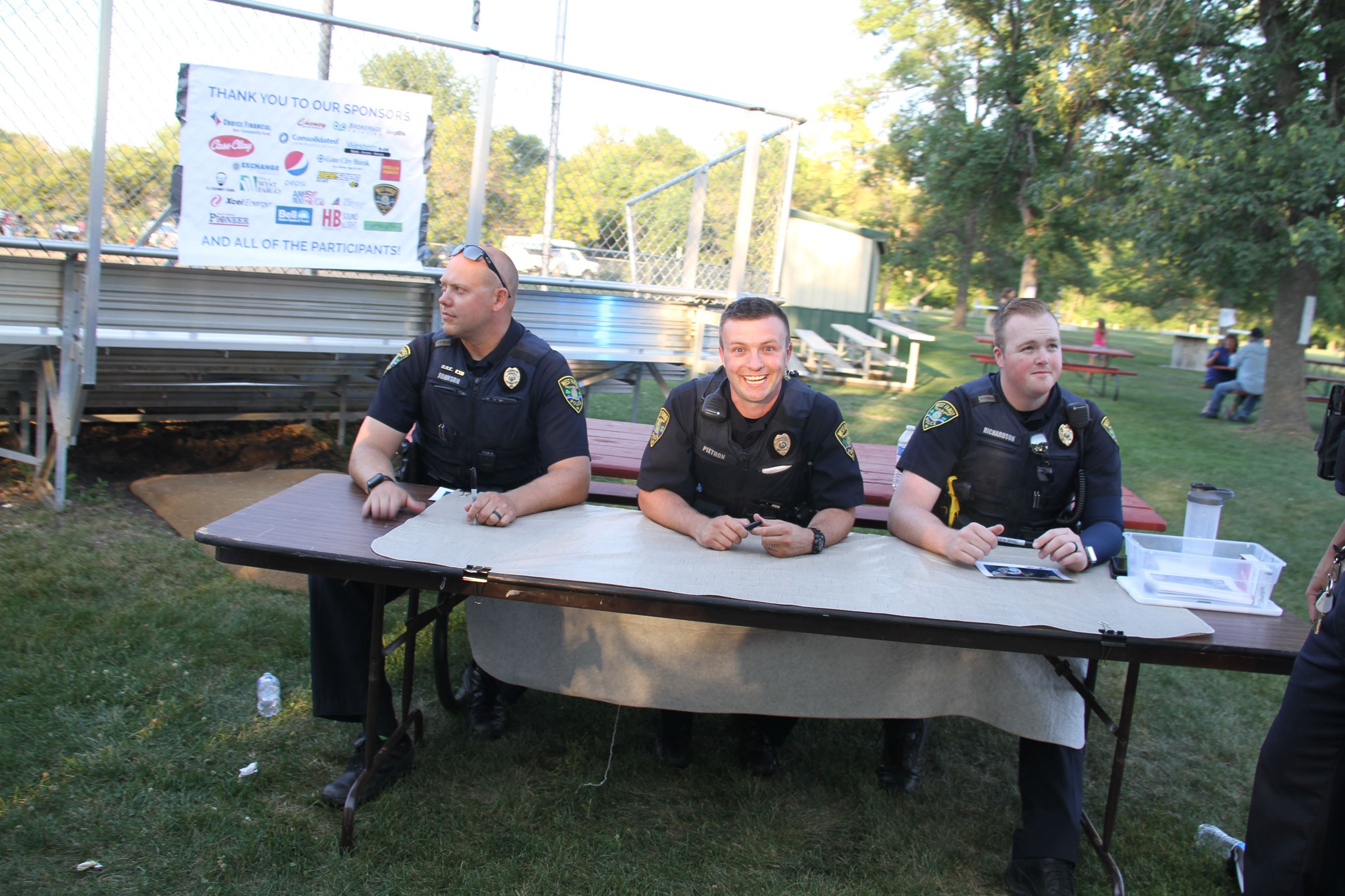 Officer Johnson, Pietron and Richardson sign autographs