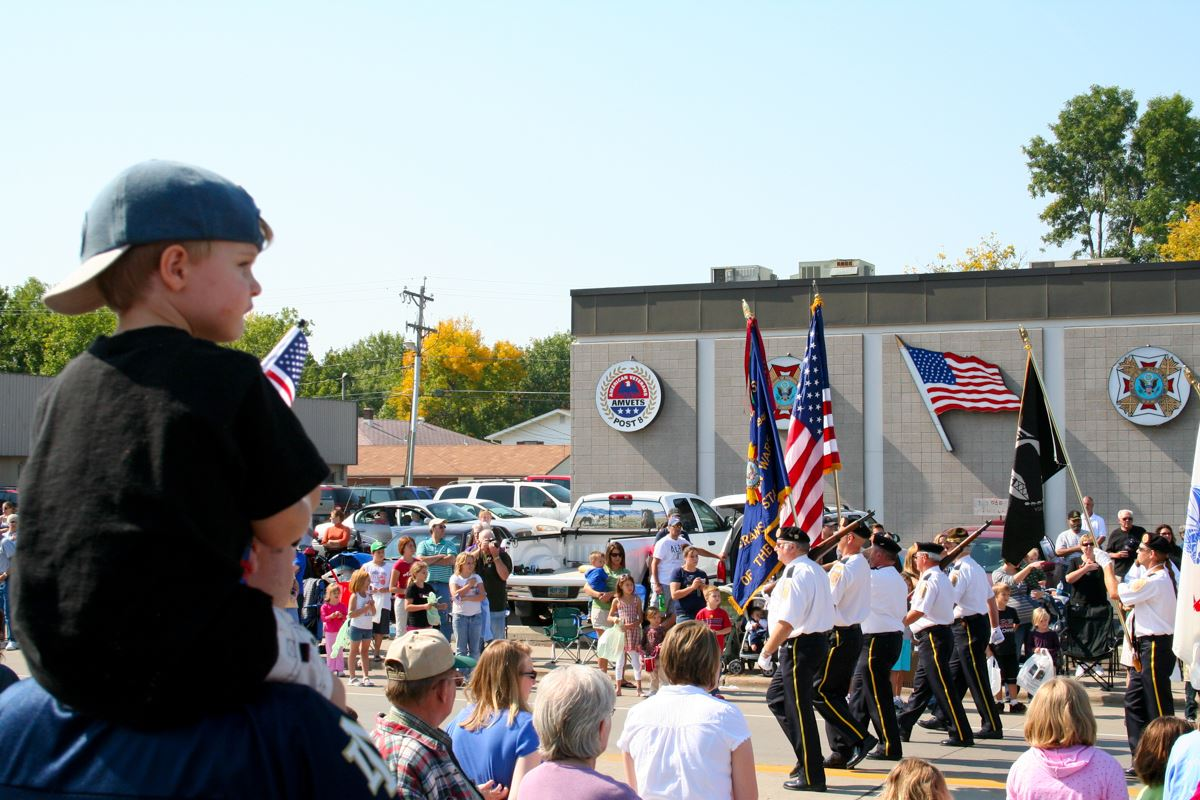View of parade veterans with flags