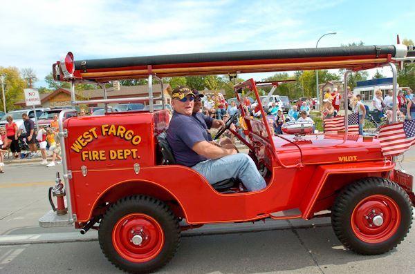 Red antique fire truck in parade