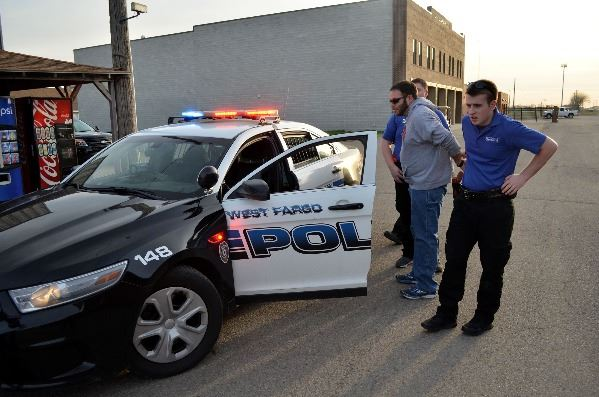 West Fargo Police Explorers making a mock arrest during their traffic stop training.