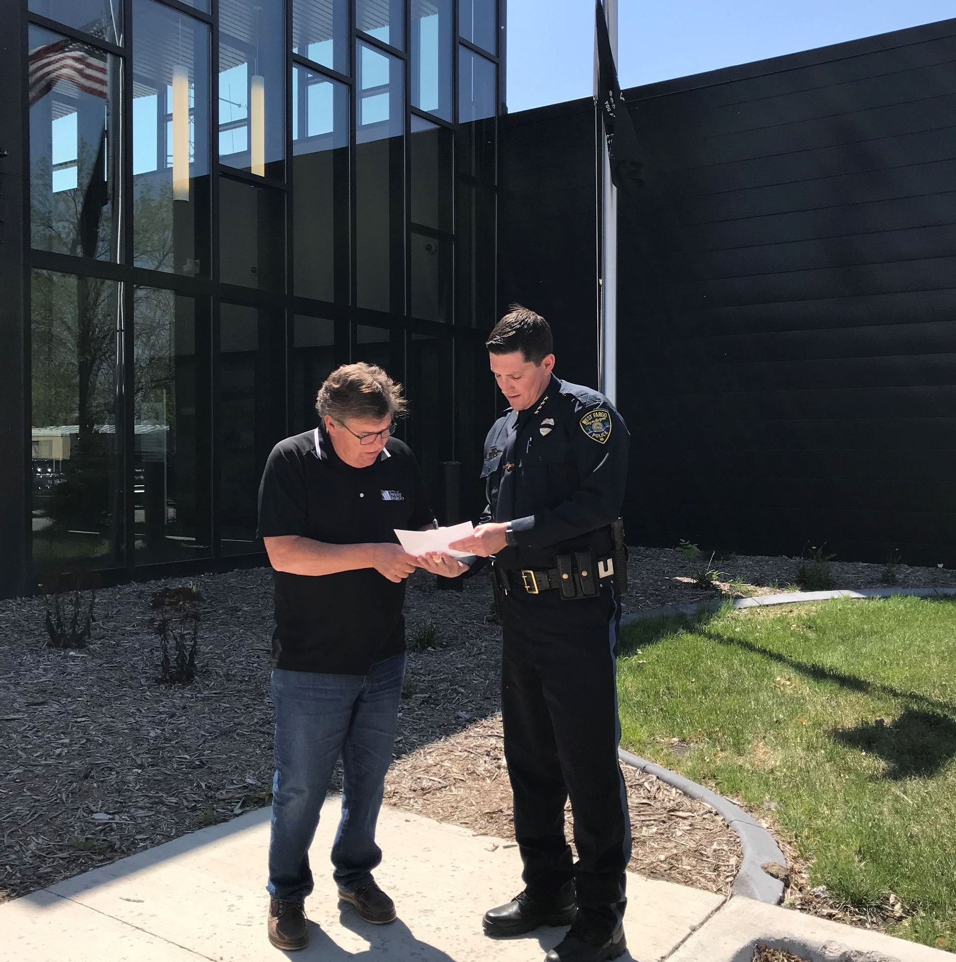 Mayor Rich Mattern signs an official proclamation to declare May 13-19 Police Week.