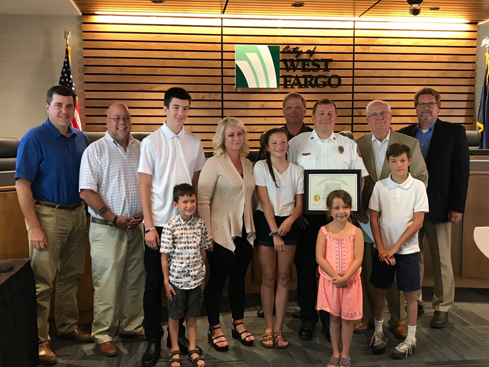 West Fargo Fire Chief Fuller poses with family and West Fargo City Commission